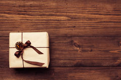Vintage gift over wooden background Royalty Free Stock Photo