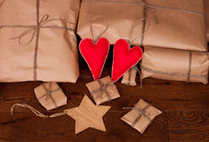 Vintage gift package and hearts. Royalty Free Stock Photo