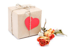 Vintage gift with a red valentine heart and a rose. Royalty Free Stock Image