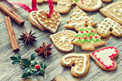 Vintage gingerbread christmas cookies on wooden background Stock Photo
