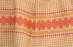 Vintage gingham fabric with trim. Yellow-orange gingham with contrasting trim Royalty Free Stock Photo