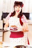 Vintage Girl Baking A Cake Stock Photos