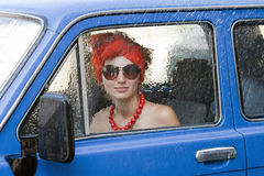 Vintage girl in car under rain Royalty Free Stock Image