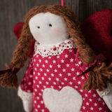 Vintage girl Christmas handmade toy. Hand made textile Girl Christmas decoration. Christmas toy. Vintage style, over wood background Royalty Free Stock Photo