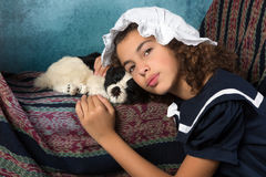 Vintage girl with dog. Sweet victorian girl posing in the old style with her dog Stock Photography