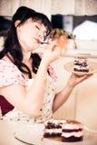Vintage Girl Enjoying A Piece Of Cake Royalty Free Stock Photography