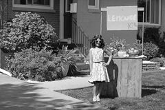 Vintage girl with lemonade stand Stock Photo