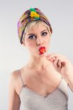 Vintage girl with lollipop Royalty Free Stock Photos