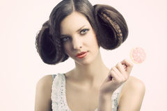 Vintage girl with lollipop. She looks Royalty Free Stock Photography