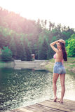 Vintage girl on mountain lake. Royalty Free Stock Image