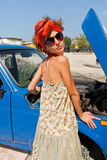 Vintage girl posing in front of the car Royalty Free Stock Photography