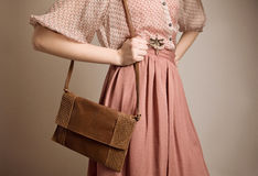 Vintage girl with purse Stock Photo