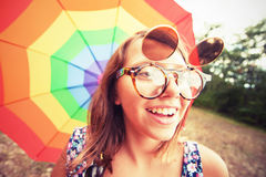 Vintage girl with rainbow umbrella Stock Image