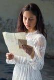 Vintage girl reading sad letter Stock Photos
