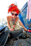 Vintage girl repairing car engine Stock Photos