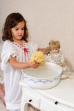 Vintage girl washing doll Stock Photography