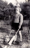 Vintage girl with wheelbarrow. Girl portrait with a wheelbarrow and a ball. The photo is taken in 1954 stock photo