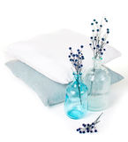 Vintage glass bottles and pillows Stock Image