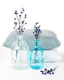 Vintage glass bottles and pillows Royalty Free Stock Photos