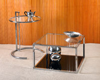 Vintage Glass and Chrome Tables with Deco Objects Royalty Free Stock Photography