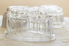 Vintage Glass Jelly Moulds. Old fashioned glass jelly or blancmange moulds for making traditional jellies stock photos