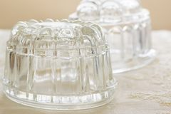 Vintage Glass Jelly Moulds. Old fashioned glass jelly or blancmange moulds for making traditional jellies royalty free stock images