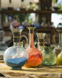 Vintage glass vials and bottles alchemy. Vintage colored glass vials and bottles alchemy Royalty Free Stock Image