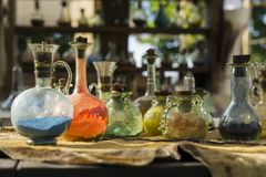 Vintage glass vials and bottles alchemy. Vintage colored glass vials and bottles alchemy royalty free stock photo