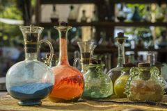 Vintage glass vials and bottles alchemy. Vintage colored glass vials and bottles alchemy Stock Images