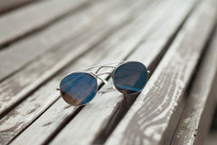 Vintage glasses on the bench Royalty Free Stock Photography