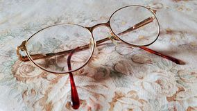 Vintage glasses on floral background stock image