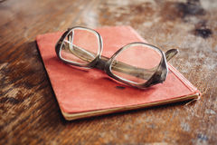 Vintage glasses on old book Stock Photo