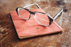 Vintage glasses on old book Royalty Free Stock Images