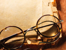 Vintage glasses on old paper Stock Photos