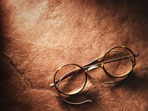 Vintage glasses on old paper Royalty Free Stock Photography