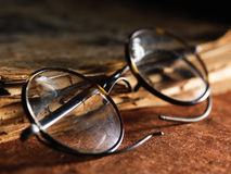 Vintage glasses on old paper Royalty Free Stock Photos