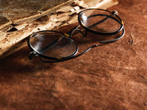 Vintage glasses on old paper Stock Photography