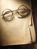 Vintage glasses on old paper Royalty Free Stock Images