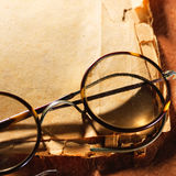 Vintage glasses on old paper Royalty Free Stock Photo