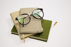 Vintage Glasses and pen on Books Stock Photography