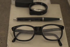 Vintage glasses, pen and magnifier Stock Images