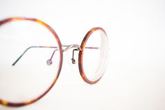 Vintage glasses on white canvas paper background close up. Stock Images
