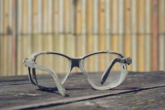 Vintage glasses on a wooden table Royalty Free Stock Photo