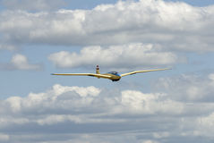 Vintage glider flying. This vintage glider made of wood and fabric with gull shaped wings,painted blue and cream,a 2 seat glider 1930's design and still flying Royalty Free Stock Image