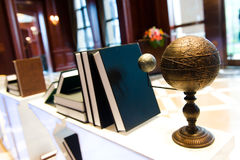Vintage globe on desk. Vintage world globe and many books sitting on a desk Stock Photo