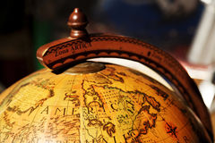 Golden Globe. Vintage globe displaying North America. High noon sunlight highlights and shadows simulate way light is cast on our planet by the sun Royalty Free Stock Images