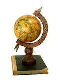 Vintage globe on old book isolated on white Royalty Free Stock Images