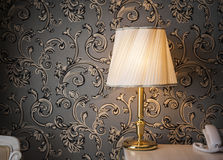 Vintage glowing lamp in the room Stock Photography