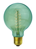 Vintage glowing light bulb. Close up vintage glowing light bulb Stock Photos