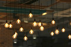 Vintage glowing light bulbs hanging. Decorative antique style light bulbs.  royalty free stock photos